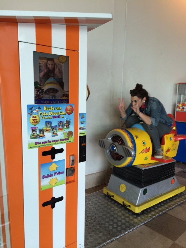 Since I'm not supposed to take photos of my Spanish kids, here's a photo of me trying to squeeze my large ass into a child's photobooth ride.
